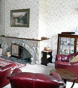 Sitting room at 6 Armstrong Cottages, self-catering cottage in Bamburgh  Village, Northumberland, UK