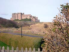 View of Bamburgh Castle from garden at 6 Armstrong Cottages, self-catering cottage in Bamburgh  Village, Northumberland, UK