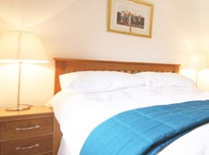 Master bedroom at Eider Self-catering Cottage in Warren Mill, Northumberland, UK