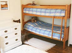 Bunk beds at Eider Self-catering Cottage in Warren Mill, Northumberland, UK