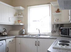 Kitchen at Eider Self-catering Cottage in Warren Mill, Northumberland, UK