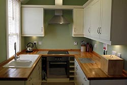 Kitchen at 6 Armstrong Cottages, self-catering cottage in Bamburgh  Village, Northumberland, UK