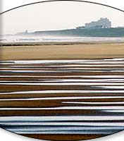 Bamburgh Castle and Bamburgh Beach, Northumberland, UK